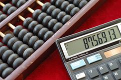 Old abacus and modern calculat Stock Image