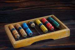 Old abacus with multi-colored knuckles Stock Photo
