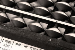 Old abacus and a paper Stock Photos