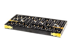 Old abacus. A traditional old black abacus isolated over a white background Stock Image