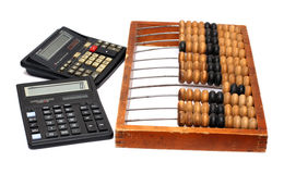 Old abacus and two calculators Royalty Free Stock Photography