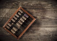 Old abacus on wood table Royalty Free Stock Images