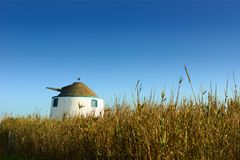 Old Windmill in the middle of a field Royalty Free Stock Images
