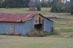 Old abandon barn in the middle of nowhere Stock Images