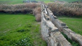 Old abandonec aquaduct in larnaka Stock Photo