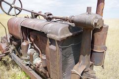 Old abandoned antique tractor. Royalty Free Stock Photo
