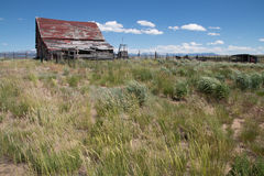 Old Abandoned Barn in the Arapaho National Wildlife Refuge. In the wind-swept area known as North Park, CO, is the Arapaho National Wildlife Refuge. This old Stock Photo