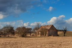 Old abandoned barn in the Czech countryside. Spring weather in the fields. Agricultural farm. Old abandoned barn in the Czech countryside. Spring weather in the royalty free stock image