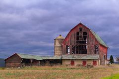 Old Abandoned Barn with Dark Cloudy Day Royalty Free Stock Photo
