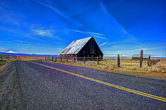 Old abandoned barn on the plains with Mt Hood in the background HDR stock image