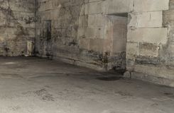 Old abandoned basement in the castle. Old abandoned basement in a castle with corridors and labyrinths Royalty Free Stock Photos