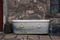 Old abandoned bathtub. Old white vintage abandoned bathtub Stock Photos