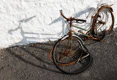 An old abandoned bicycle. And a white wall Royalty Free Stock Photos