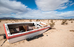 Old abandoned boat in the desert Stock Photos