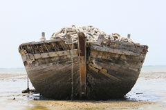 Old abandoned boat on shore Royalty Free Stock Photos