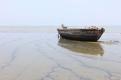 Old abandoned boat on shore Stock Images