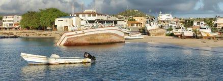 Old abandoned boats on Puerto Baquerizo Moreno Stock Photo