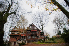 Old abandoned brick  mystic mansion. Gothic building at autumn Royalty Free Stock Photo