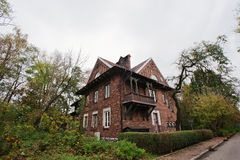 Old abandoned brick  mystic mansion. Gothic building at autumn Royalty Free Stock Photos
