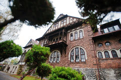 Old abandoned brick  mystic mansion. Gothic building at autumn Stock Photos