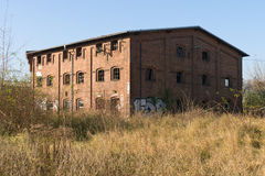 The old and abandoned building. The old and abandoned buildings in the sunset. Autumn Stock Photo