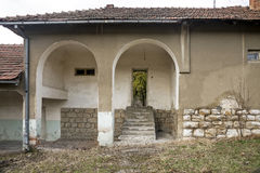Old abandoned building with arc pillars and a porch in the villa. Ge Stock Photography