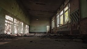 Old abandoned building. General plan of the room. Cinematic plan. The sun shines through the Windows. stock video