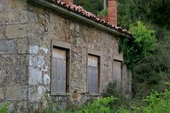 Old abandoned building in the middle of a forest in europe royalty free stock photo
