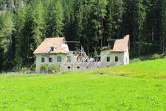An old abandoned building in ruins, Dolomites, Italy stock images