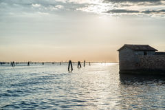 Old abandoned building of San Giacomo in Paludo island in Venice lagoon at sunset Royalty Free Stock Image