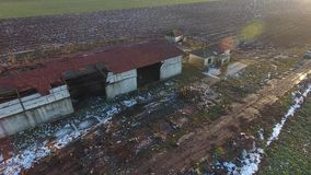 Old abandoned building seen from drone. Drone view over an abandoned building, winter time stock video footage