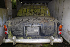 Old abandoned car. With graffiti in a garage royalty free stock image