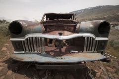 Old abandoned car with bullet holes Royalty Free Stock Photos