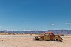 Old and abandoned car in the desert of Namibia, spot known as solitaire. Africa royalty free stock photos