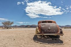 Old and abandoned car in the desert of Namibia, spot known as solitaire. Africa royalty free stock image