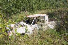 Old abandoned car. In grass Stock Photos