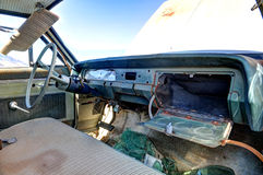 Old abandoned car interior with open glove box Royalty Free Stock Images