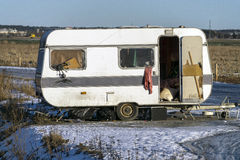 Old abandoned caravan. An old abandoned caravan on a field outside the city Stock Photography