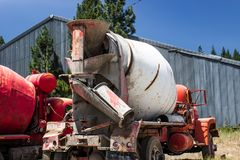 Old Abandoned Cement Mixer In Salvage Yard. Old Abandoned Encrusted Cement Mixer Truck In Vehicle Salvage Yard stock photos