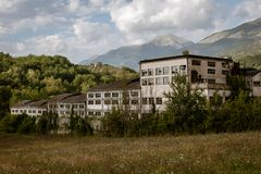 Old factory on mountain landscape stock photography