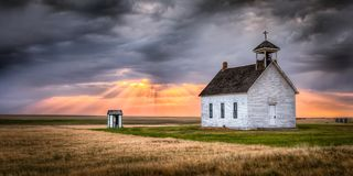 Abandoned Church at Sunset with Sun Rays royalty free stock image
