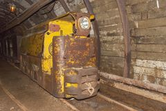 An old, abandoned coal mine and mine train. Coal mining in the underground mine. Stock Photography