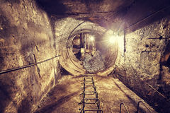 Old abandoned coal mine ventilation tunnel. Stock Photography