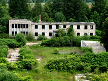 Old abandoned concrete building. Interesting abandoned building. Relic of the communism period in Poland Royalty Free Stock Photo