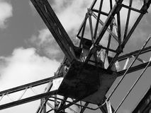 Old abandoned container crane peeling and rusting in unused dock royalty free stock photography
