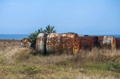 Old abandoned corroded fuel tanks stock image