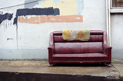 Old abandoned couch dumped on Chinese street Stock Images