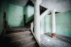 Old abandoned creepy manor house room. Stairs to the second floor. Stock Photography