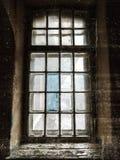Old abandoned dark grunge window. Vertical background Stock Images