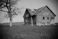Old, abandoned, decrepit farm house Stock Photos